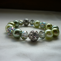 SHADES OF GREENS AND SILVER  BRACELET.  811