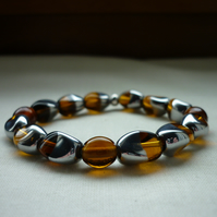 AMBER, BROWN AND SILVER BARACELET.  821