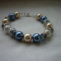 BLUE, CREAM AND SILVER BRACELET.  812