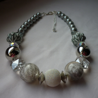 SILVER, GREY AND CRYSTAL CHUNKY NECKLACE.  920