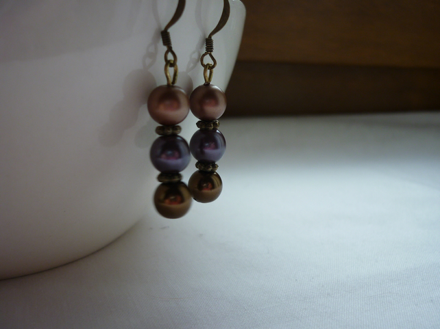 EGGPLANT, COFFEE AND BRONZE EARRINGS.  291