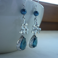 SAPPHIRE BLUE AND STERLING SILVER EARRINGS.  734