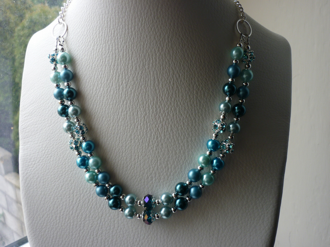 TEAL, BLUE, TURQUOISE AND AQUA CRYSTAL TWO STRAND NECKLACE. 749