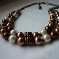 CINNAMON, BRONZE, OLD GOLD AND IVORY TWO STRAND NECKLACE.  752