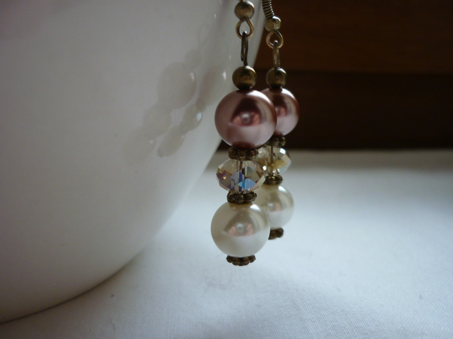 CINNAMON, IVORY AND CHAMPAGNE CRYSTAL EARRINGS.  754