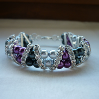 DARK GREY, SILVER AND MAGENTA RHINESTONE BRACELET.  928