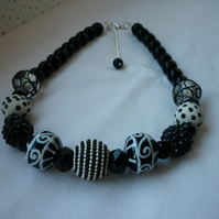 BLACK AND IVORY CHUNKY NECKLACE.  960