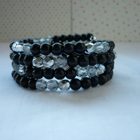 BLACK, SILVER AND CRYSTAL MEMORY WIRE BRACLET.  961