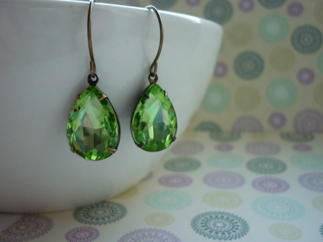 PERIDOT GREEN AND PATINA BRASS PEAR TEARDROP RHINESTONE EARRINGS.  973