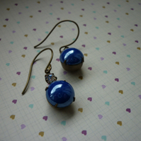 BLUE, CRYSTAL AND VINTAJ BRASS EARRINGS.  1025