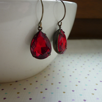 RUBY RED & PATINA BRASS RHINESTONE TEAR DROP EARRINGS.  1024