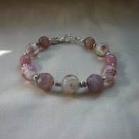 SHADES OF PINK AND SILVER LAMPWORK BEADED BRACELET.  1032