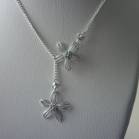 SILVER FLOWER LARIAT DESIGN NECKLACE.  1063