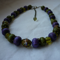 MOSS GREEN, PURPLE AND ANTIQUE BRONZE NECKLACE.  999