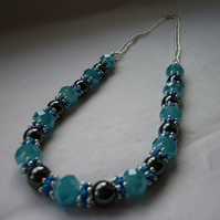 TROPICAL SEA, HEMATITE, BLUE AND SILVER NECKLACE.  995