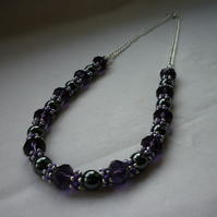 PURPLE, HEMATITE AND SILVER NECKLACE.  997