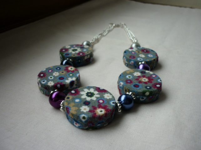 FLORAL GREY FABRIC COVERED BEADS AND SILVER NECKLACE.  1004
