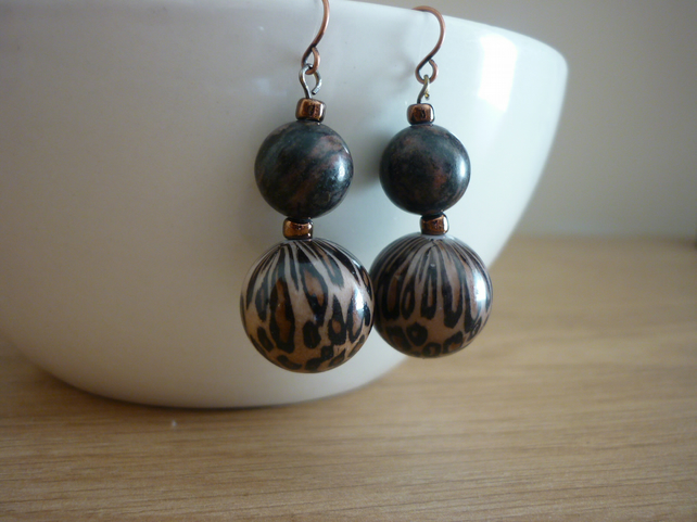 ANIMAL PRINT AND ANTIQUE COPPER EARRINGS.