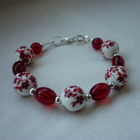 RED, WHITE AND SILVER CERAMIC BEAD BRACELET  1075