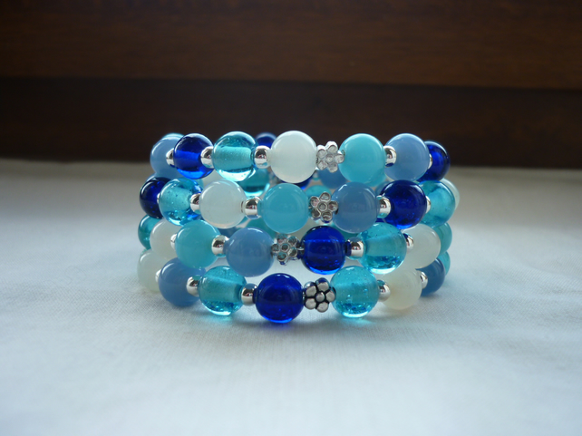 AQUA, TURQUOISE, BLUES, GREENS, WHITE AND SILVER MEMORY WIRE BRACELET.  1082