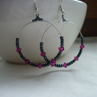 HEMATITE, FUSCHIA  AND SILVER HOOP EARRINGS.  1084
