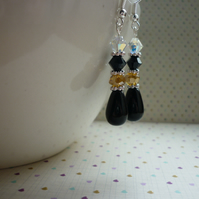 BLACK, CHAMPAGNE, CRYSTAL AND SILVER DANGLE EARRINGS.