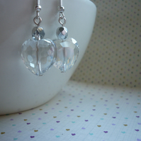 CLEAR CRYSTAL AND SILVER FACETED HEART EARRINGS.