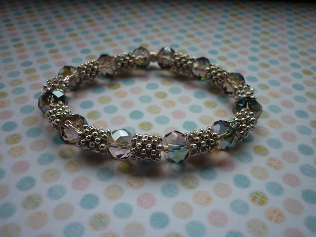 GREEN AB, ROSE AB AND SILVER BRACELET.