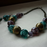 AMETHYST, TEAL AND ANTIQUE BRONZE GLASS BEAD NECKLACE.