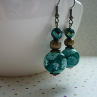 TEAL AND ANTIQUE BRONZE FLORAL GLASS BEAD EARRINGS.