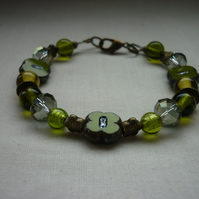 SHADES OF GREEN AND ANTIQUE BRONZE BRACELET.