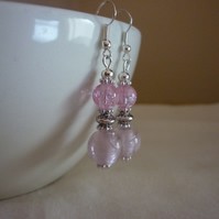 PINK AND SILVER GLASS BEAD DANGLE EARRINGS.