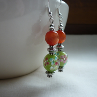 BURNT ORANGE, GREEN AND SILVER DANGLE EARRINGS.