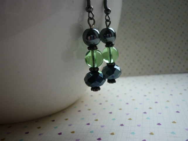HEMATITE AND PALE GREEN EARRINGS.  748