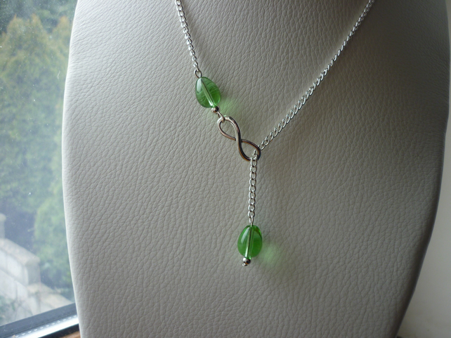 GREEN AND SILVER INFINITY LARIAT DESIGNED NECKLACE.