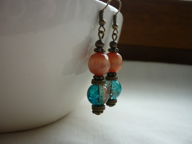 TEAL, ORANGE, BROWN AND ANTIQUE BRONZE DANGLE EARRINGS.