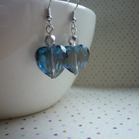 SAPPHIRE BLUE AND SILVER HEART EARRINGS.