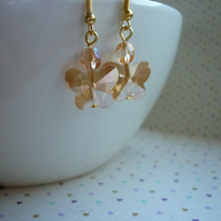 GOLD FACETED BUTTERFLY EARRINGS.