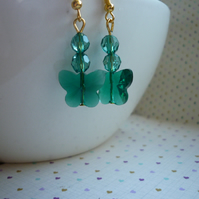 TEAL GREEN AND GOLD FACETED GLASS BUTTERFLY EARRINGS.