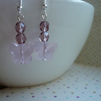 SHADES OF PINK AND SILVER FACETED GLASS BUTTERFLY EARRINGS.