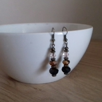 BLACK, BRONZE, CHAMPAGNE AND ANTIQUE BRONZE EARRINGS.
