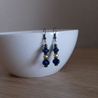 SAPPHIRE BLUE, GOLD AND ANTIQUE BRONZE EARRINGS.