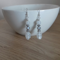 CRYSTAL, WHITE AND SILVER DANGLE EARRINGS.