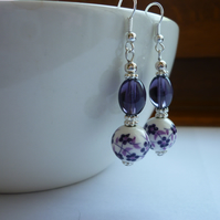 PURPLE, WHITE AND SILVER FLORAL PORCELAIN EARRINGS.  1046