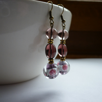 AMETHYST, PINK, SILVER AND BRONZE LAMPWORK BEAD EARRINGS.