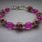 DEEP PINK, WHITE AND SILVER, FLORAL CERAMIC BEAD BRACELET.