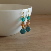 TEAL, COPPER AND GOLD FLOWER DESIGN EARRINGS.