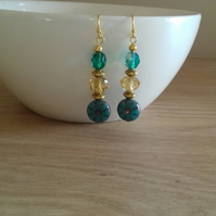 TEAL AND GOLD FLOWER GLASS BEAD EARRINGS.