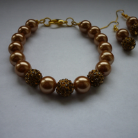 ANTIQUE BRONZE AND GOLD - PEARL AND PAVE BEADED BRACELET AND EARRING SET.