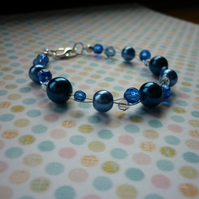 SHADES OF BLUE AND CRYSTAL BRACELET.